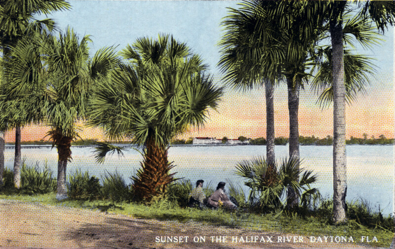 Two People Enjoy the Sunset on the Halifax River, Daytona, Florida