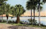 Two People Enjoy the Sunset on the Halifax River, Daytona, Florida
