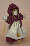 Utah Pioneer Woman Holding Wax Candles Made with Beeswax (Three Quarter View)