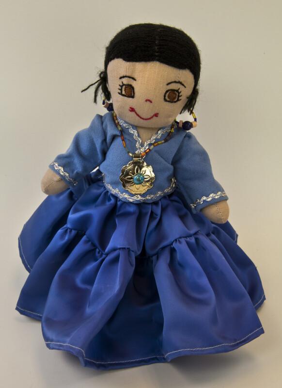 Utah Stuffed Indian Doll Wearing Blue Shirt and Flared Skirt (Full View)