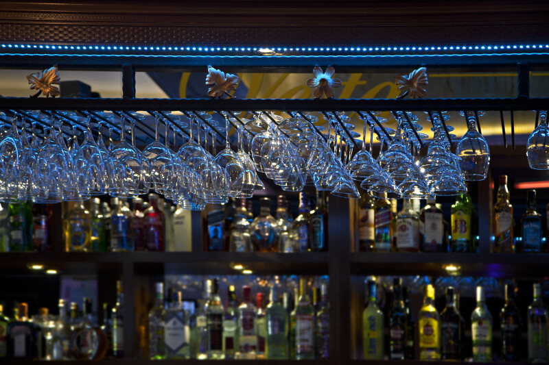 Variety of Hanging Glasses at a Bar