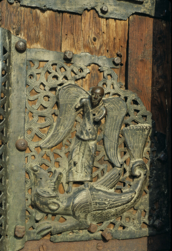 Verona, San Zeno, bronze doors, St. Michael and the dragon
