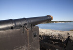 View of a Cannon  with Leather Cover Strapped Over the Opening of the Barrel