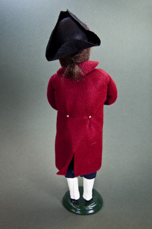 Virginia Williamsburg Figurine of Caroler with Tri-Corner Hat and Pony Tail (Back View)