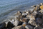 Water from the Aegean Sea Splashing Against Rocks