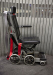 Wheelchair with Red and Gray Straps