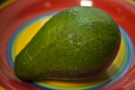 Whole Avocado on a Colorful Plate