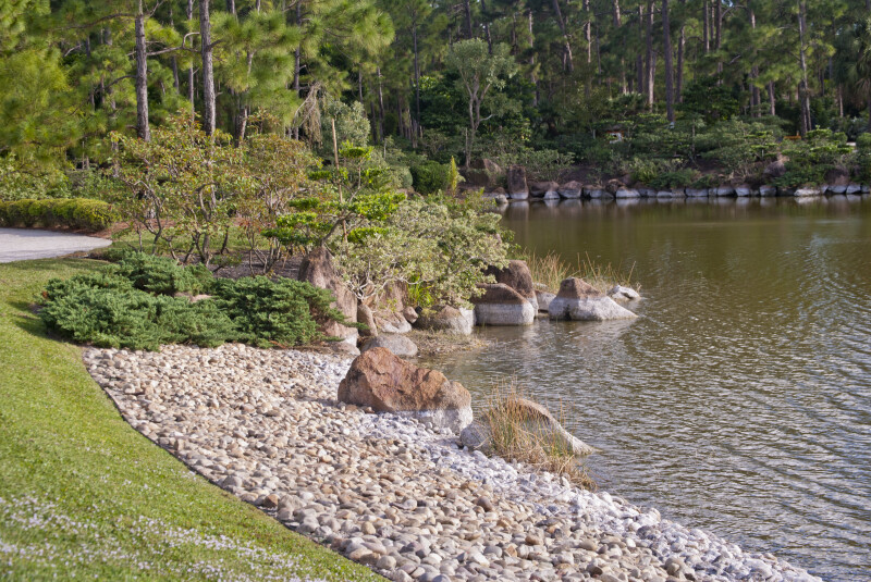 Wind Blowing Water to Rocky Shore of Pond
