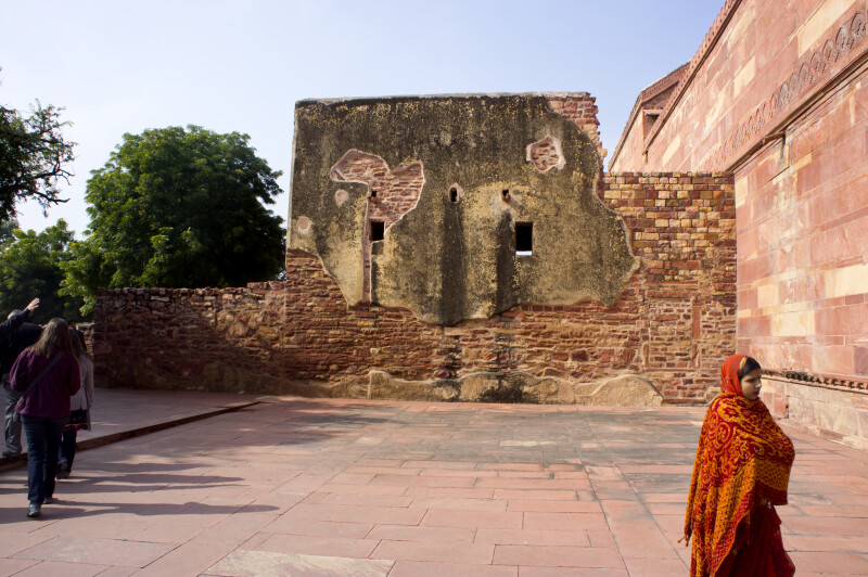 Woman Walking in Courtyard