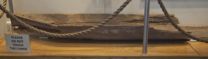 Wooden Dugout Canoe on Display Behind Rope