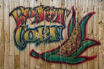 Wooden Fence with Picture of Roasted Corn