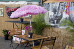 Wooden Table with Pink Umbrella