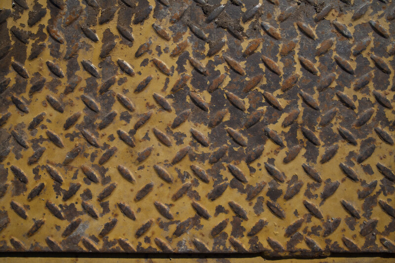 Worn, Painted Diamond Plate on Construction Vehicle