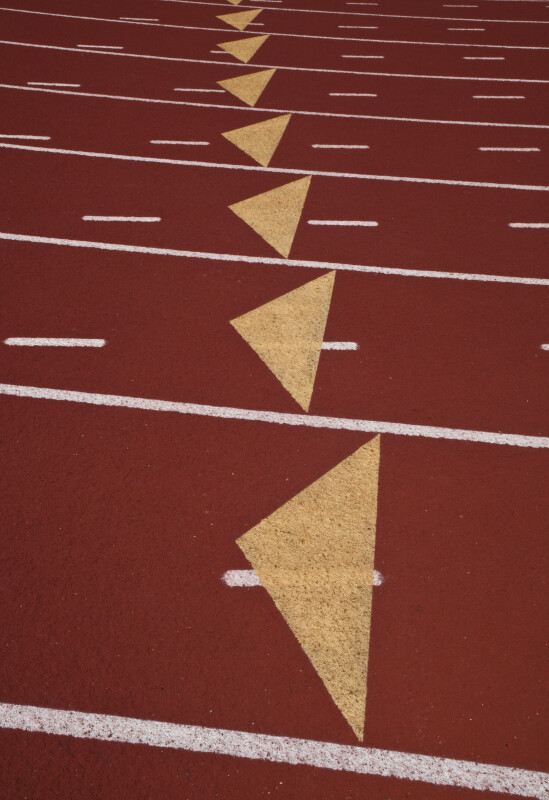 Yellow Triangles in White Lines of Running Track