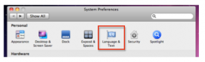 System Preferences window with Language and Text highlighted.
